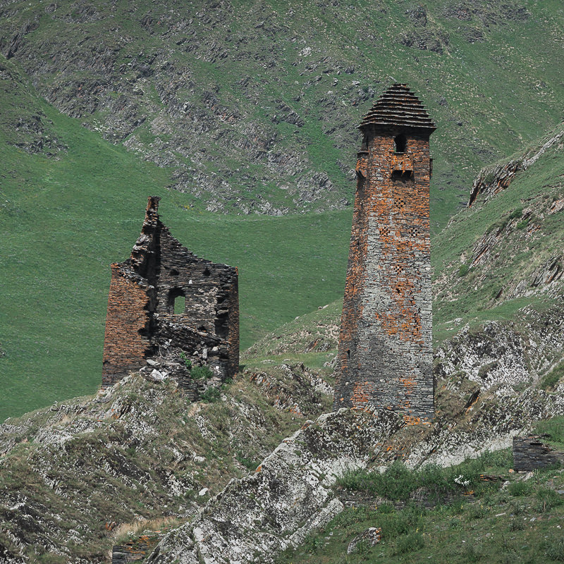 A tall defence tower rises from the rocky slope above the village of Girevi on the Shatili to Omalo trek in Georgia