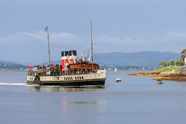 Ultimate Glasgow Guide: The Waverley Paddle Steamer cruising into Rothesay, Isle of Bute, Scotland