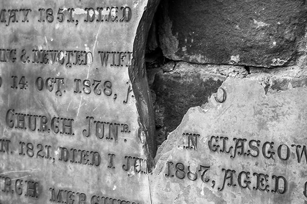 Ultimate Glasgow Guide: Detail of a broken grave stone plaque at Glasgow Necropolis