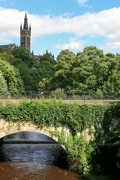 Ultimate Glasgow Guide: The view up to Glasgow University from the Argyle St bridge over the River Kelvin, Glasgow