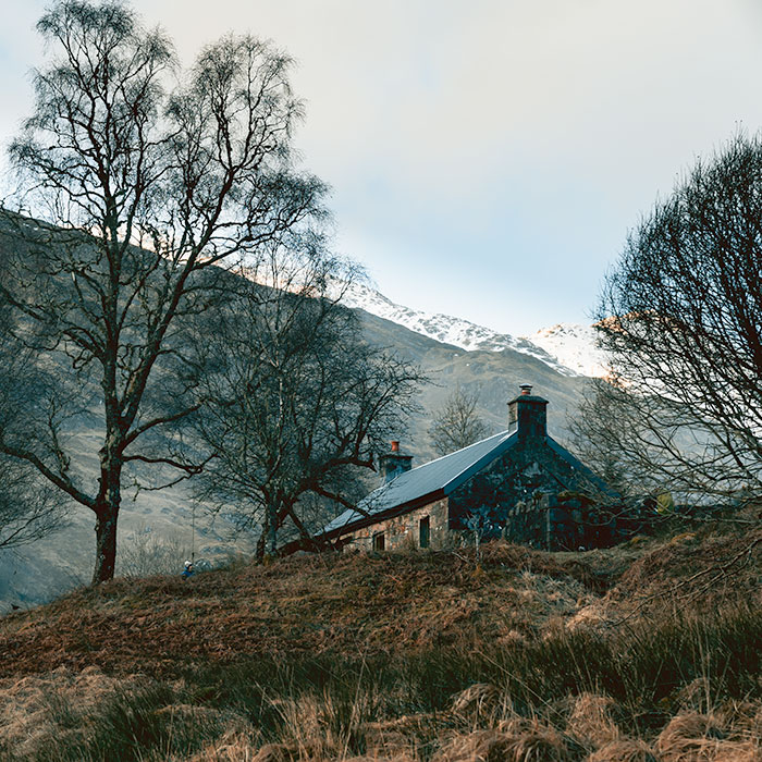 Gleann Dubh-Lighe Bothy on a cold February afternoon among the dry winter grass, seen from the trail below