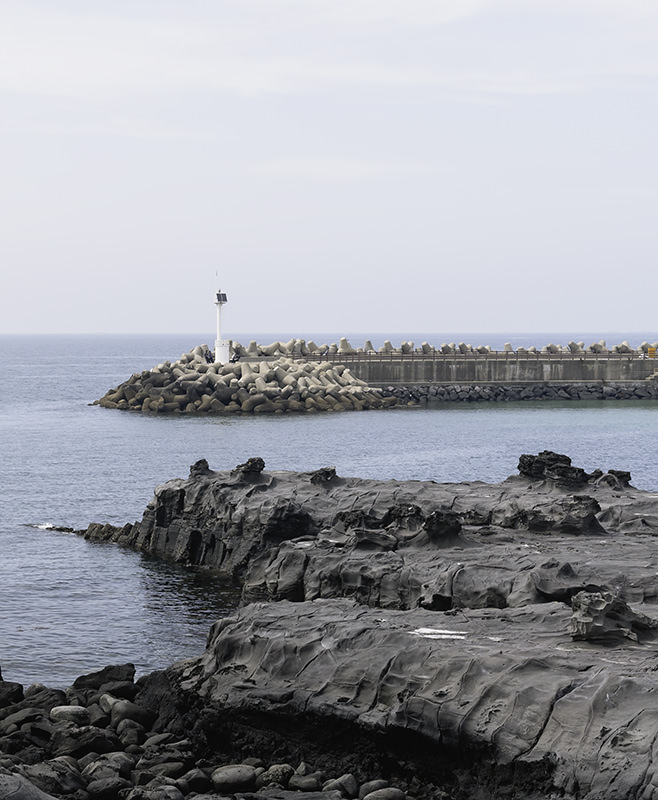Flat areas on the rocky shore at Gueom on Jeju Island where people used to harvest salt