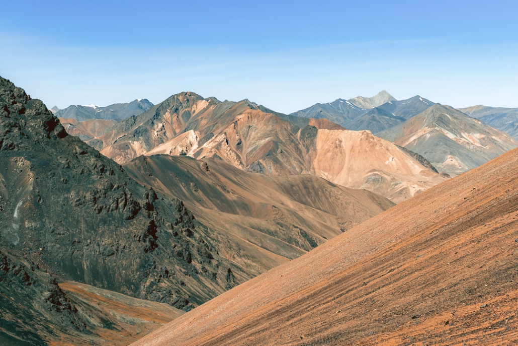 The view from 4700 metres at the Gumbezkol Pass, looking back towards the orange mountains of the Pshart Valley in eastern Tajikistan