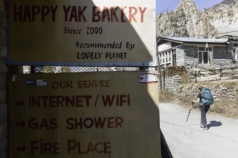A close up of the hand painted sign for the Happy Yak Bakery in Braka