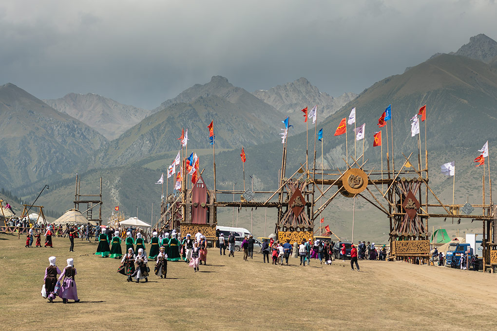 The crowds head towards one of the many gates at the World Nomad Games festival site in Kyrchin Valley. The site was split up into different ordos - places representing towns, cities and areas around Kyrgyzstan.