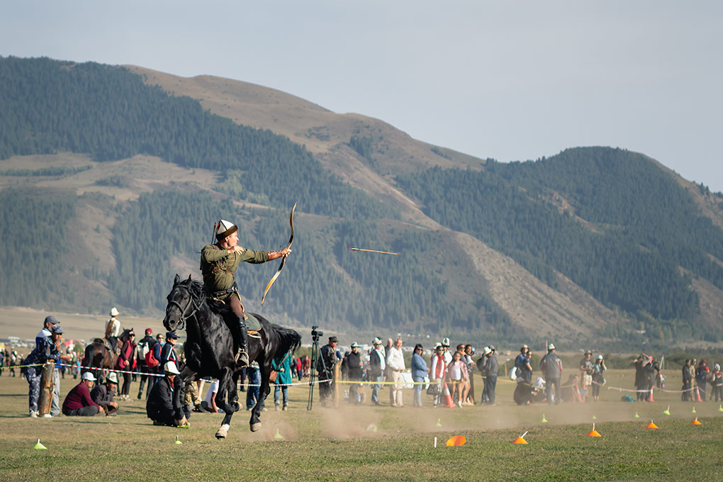Horseback archery is one of the most exciting and eagerly anticipated sports at the World Nomad Games. The combination of core strength and skill from this Hungarian archer was a sight to behold. Looking behind as his black horse gallops forward, he looses an arrow towards the target while admiring crowds look on.