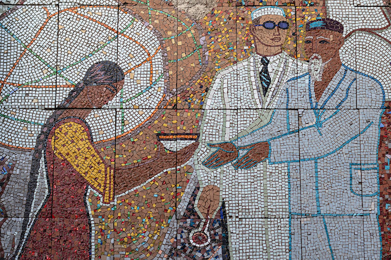 A close-up of the fantastic mosaic at the National Center for the Tuberculosis Problem (formerly Tubdispanser). A woman holds out her bowl for the doctors.