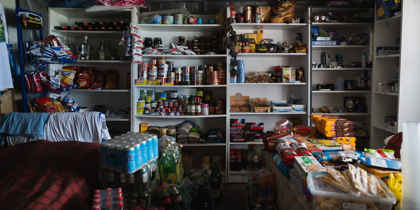 Shelves stocked with a variety of food, drinks, and snacks at Hostel Tishe in Lower Omalo, Tusheti, Georgia