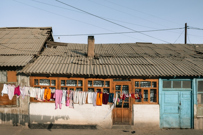 Clothes hung out to dry in front of a house in Murghab in the afternoon sunshine.