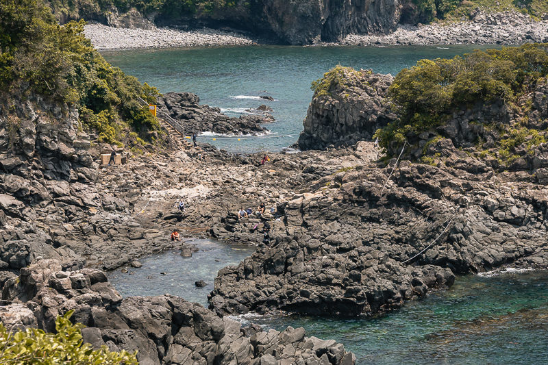 Looking down from a cliff on the Hwanguji swimming holes on the rocky coast near Seogwipo on Jeju Island