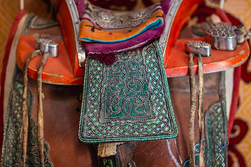 A ceremonial saddle on the wall inside a herdsman's ger, The Gobi, Mongolia