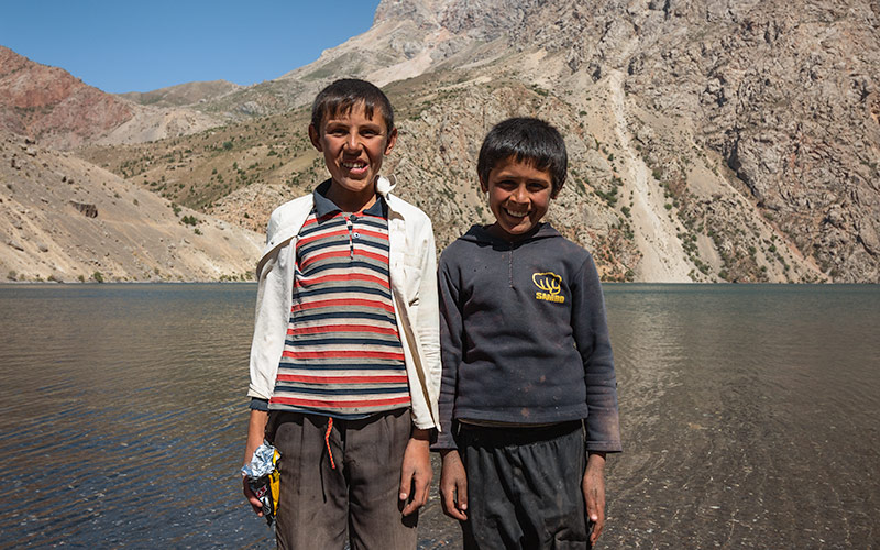 Two local boys keeping us company at the 7th lake of the Haft Kul while Fann Mountains trekking in Tajikistan