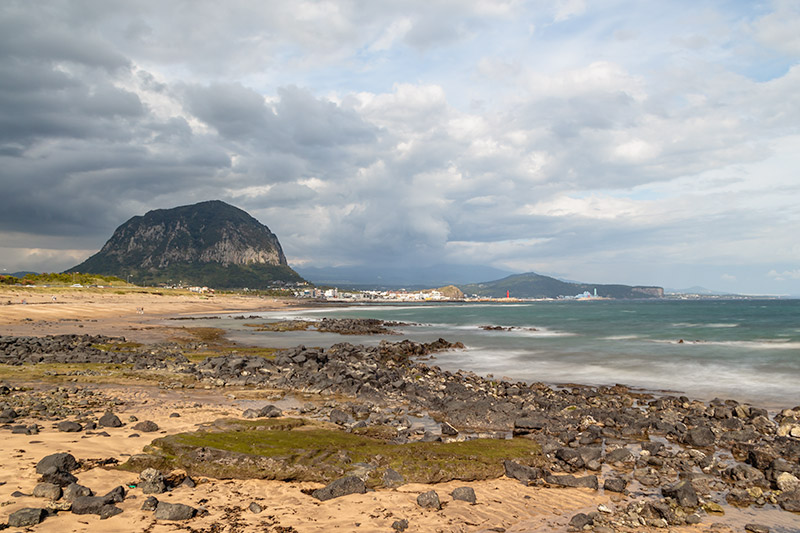 A view of Sagye Beach and bell shaped Sanbangsan Mountain on a windy, overcast day.