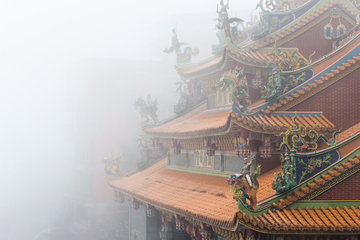 Images of Taiwan: A temple emerges from the heavy mist in Jiufen