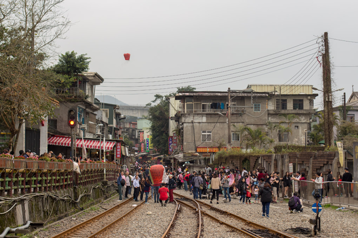 Images of Taiwan: Crowds cover the rail track at Shifen Old Street, preparing and releasing their sky lanterns