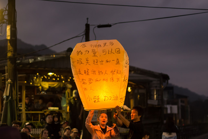 Images of Taiwan: People enjoy the sight of their lantern the moment before release in Pingxi, near Taipei
