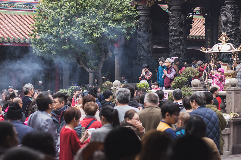 People pray in front of the main hall at Longshan Temle, Taipei