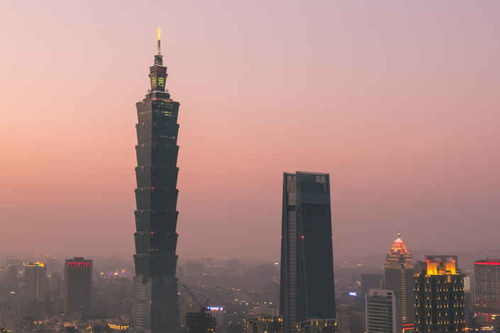 Images of Taiwan: The striking Taipei 101 and a pink hued sunset seen from Elephant Mountain in Taipei