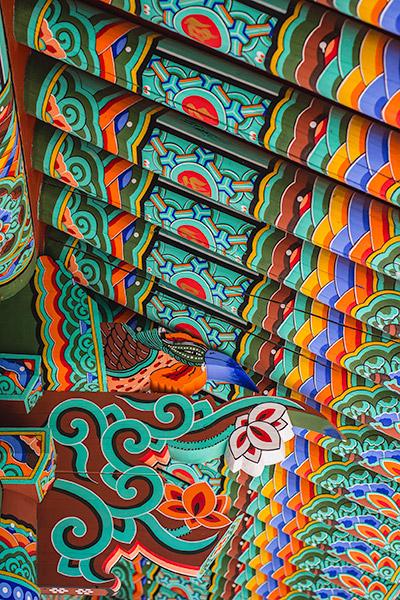 Colourful beams and cool wood carvings at Yonghwasa in Tongyeong