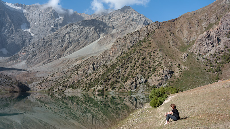 Taking in the view on the shore of Kulikalon while Fann Mountains trekking in Tajikistan