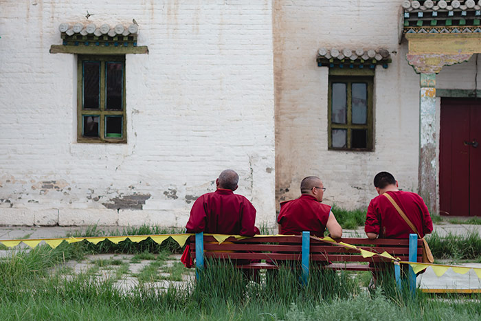 Budget Gobi Tour: Monks take a rest between prayer at the Erdene Zuu Monastery in KharKhorin, Central Mongolia