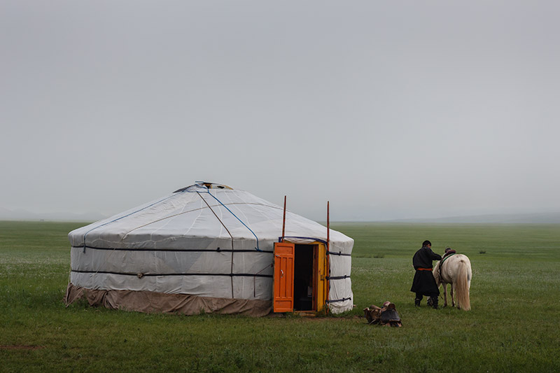 7 Days In The Gobi: Readying the horse for an early morning ride in the Khogno Khan Mountains in Central Mongolia