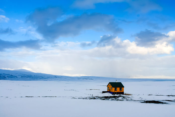 A week in Iceland - A lone yellow house in the snow, Iceland