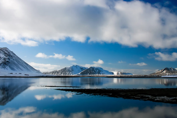 A week in Iceland - Snow capped mountains reflected in crystal clear water, Snaefellsnes Peninsula, Iceland