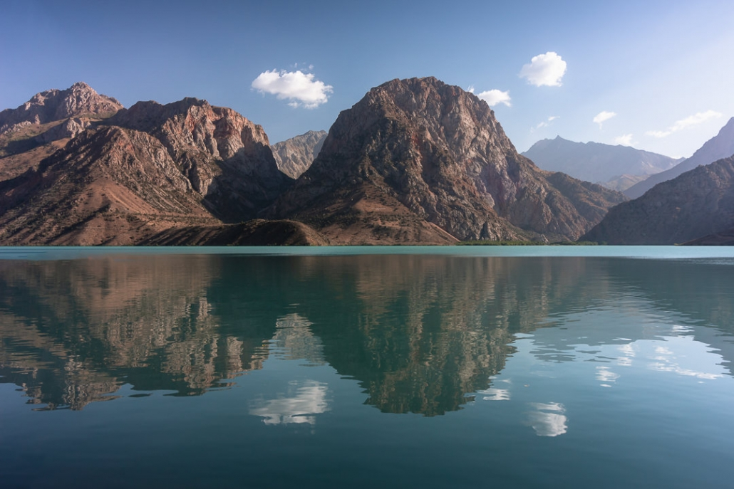 Mountains are reflected in the surface of Iskanderkul, the biggest lake in the Fann Mountains of Tajikistan