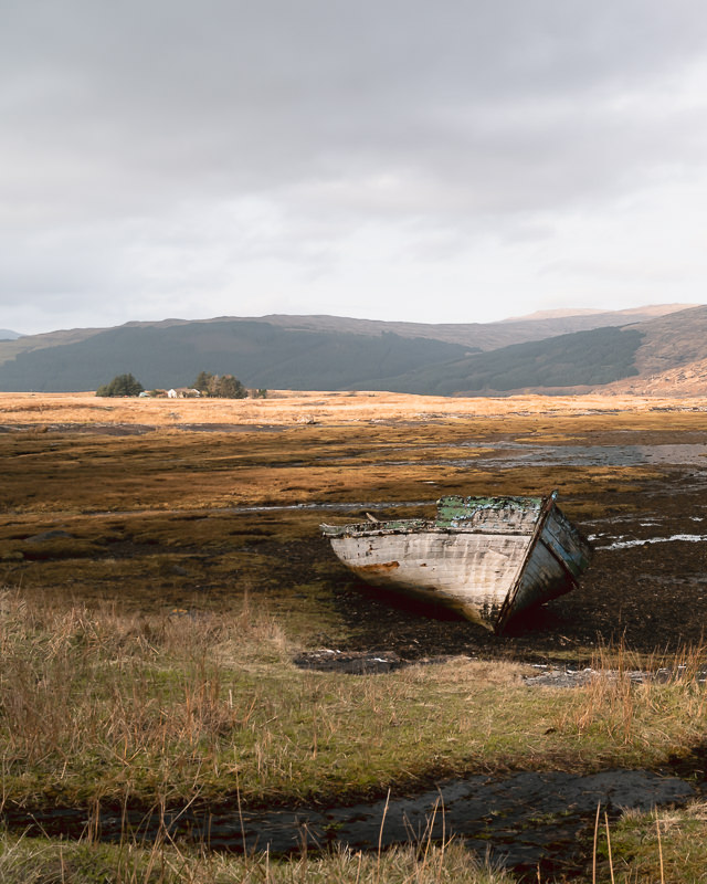 An abandoned old boat stranded on the shore of Loch Scridain on the Isle of Mull.