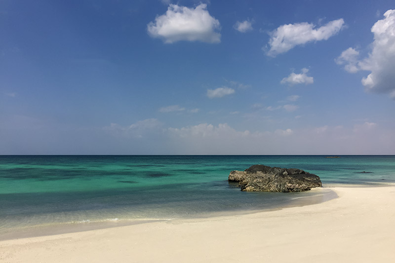 Pristine white sand and turquoise blue water on the west coast of Masirah Island, Oman.