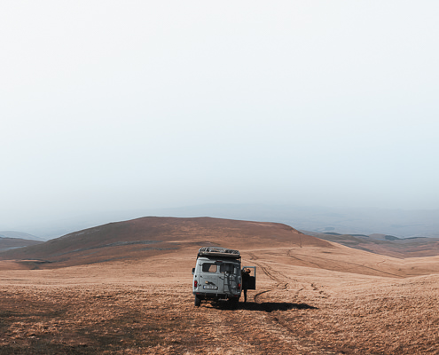 A UAZ Buhanka campervan parked at the side of a grassy track to Levani's Lake on the expansive Javakheti Plateau