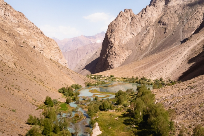 An aerial view of Jizeu Valley in the Western Pamirs, looking down towards the main village and the Bartang Valley beyond.