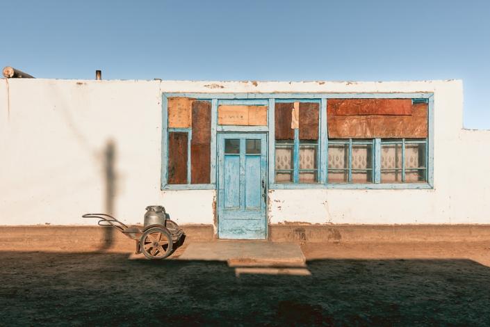 A house front in the village of Karakul in Tajikistan, shining in the early morning sun.