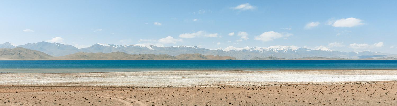 Karakul Lake and snowy peaks of the Trans-Alay Range