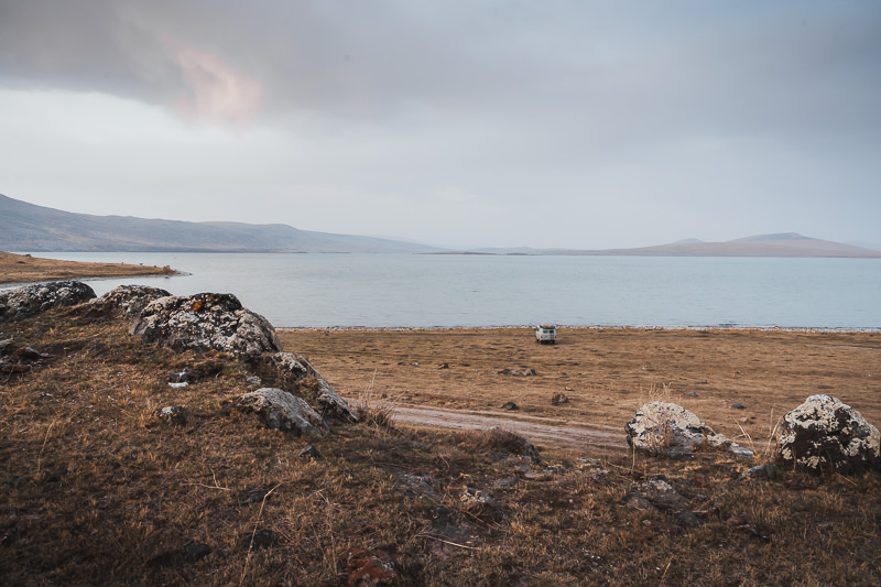 A campervan sits on the grassy shore of Kartsakhi Lake in Javakheti National Park