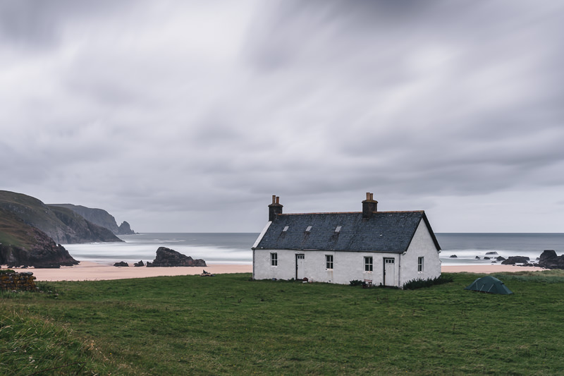 The attractively whitewashed Kervaig Bothy, perfectly situated in the spectacular bay of the same name in the far northwest of mainland Scotland