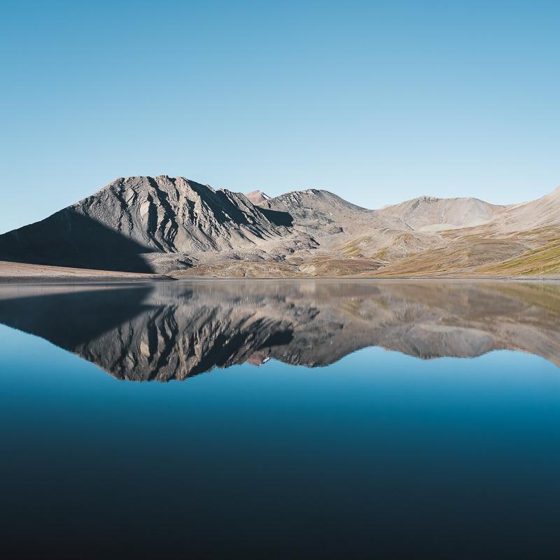 Mountains reflected in Kelitsadi Lake on a still morning