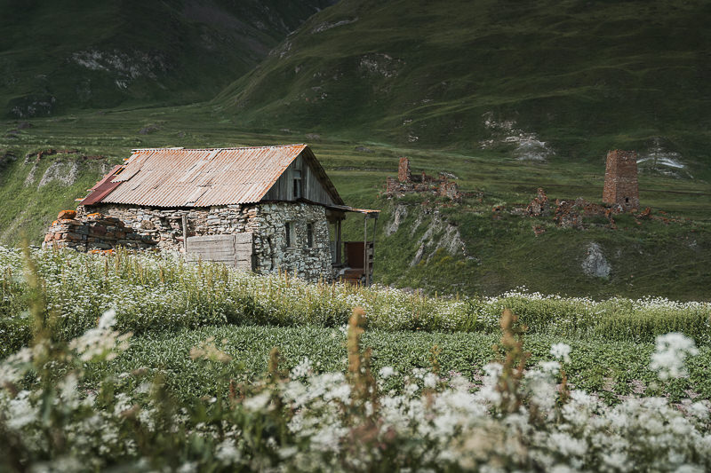 An old house in the largely abandoned village of Ketrisi in Truso Valley, with even older ruins seen across the river