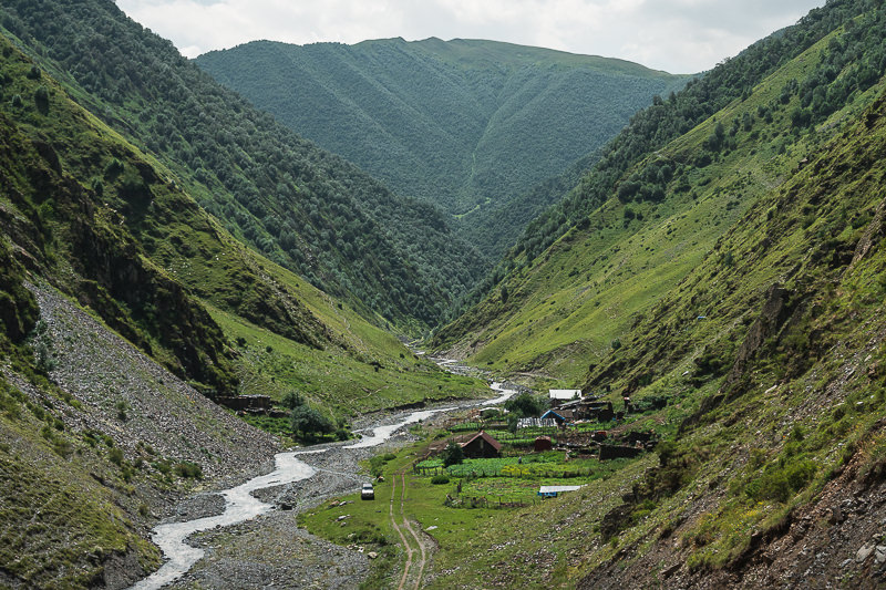 The trail passes through the village of Khonischala and follows the Khonistskali River on the Shatili Omalo trek in northern Georgia