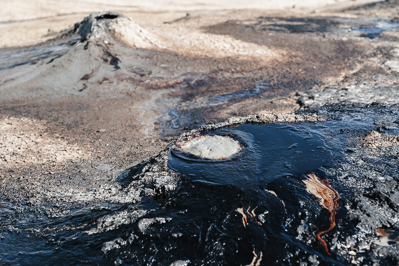 Black tar oozing out of a small crater at the Kilakupra Mud Volcanos in southeastern Georgia