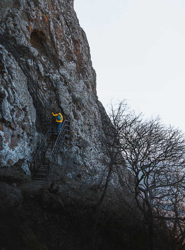 A person climbs the metal staircase to Kojori Fortress in Georgia