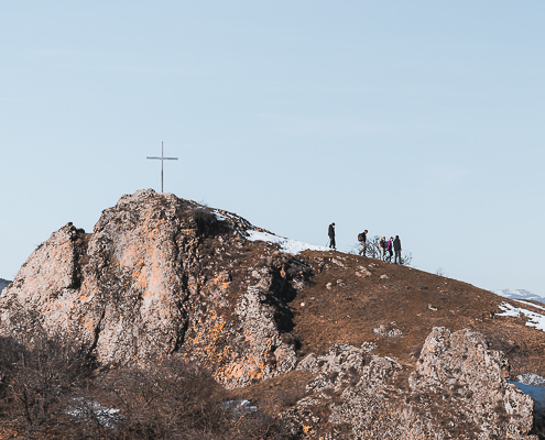 Hikers descend from the viewpoint at Kojori Fortress in Georgia