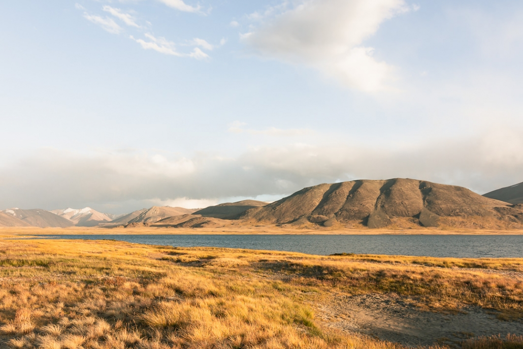 A golden glow lights up the land around Kokjigit Lake in eastern Tajikistan.