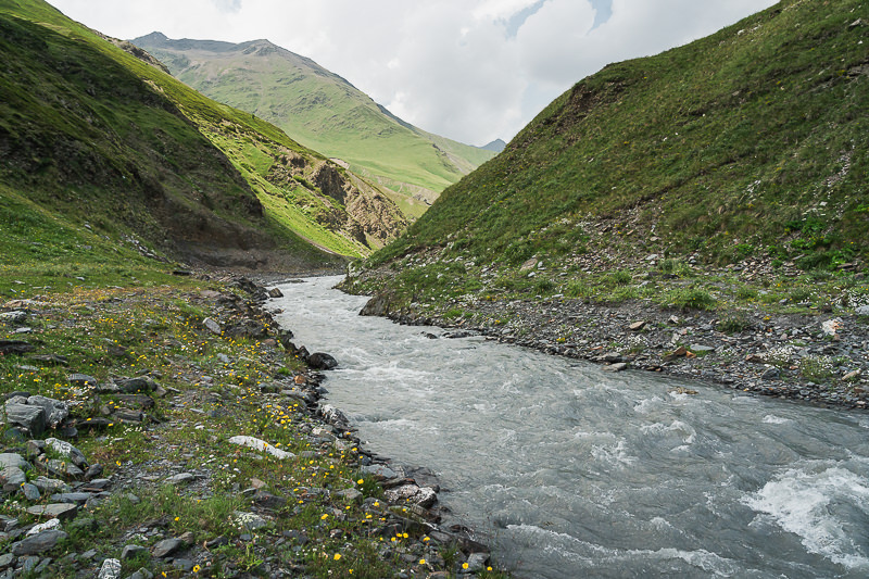 The wide, deep, and fast flowing Kvakhidistskali River on the Shatili Omalo trek in Georgia