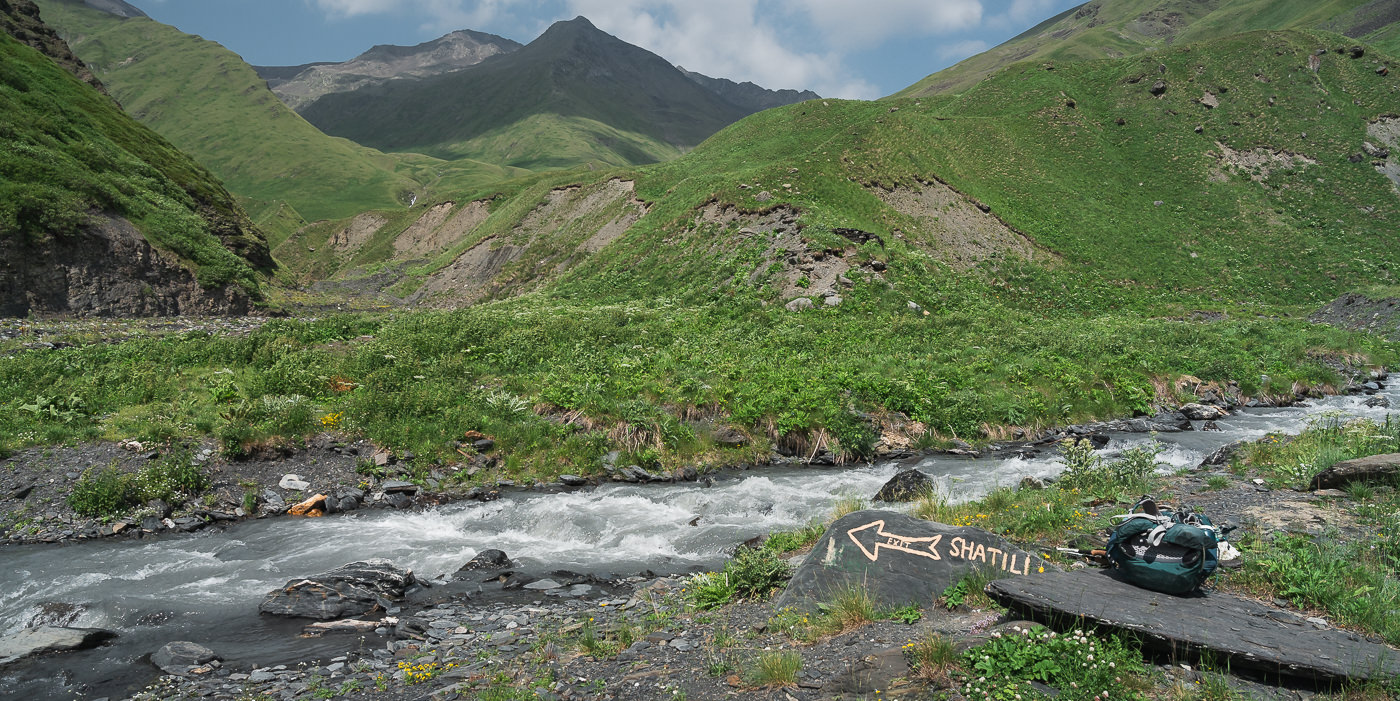 A tributary of the Kvakhidistskali river with 'Shatili' painted on a rock next to it