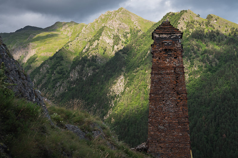 The impressive old defence tower at Kvavlo with its equally impressive mountain backdrop, high above the village of Dartlo in Tusheti, Georgia