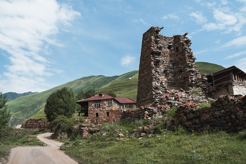Crumbling ruins sit among a few still occupied homes in the village of Kvemo Okrokana, the trailhead for the Truso Valley Hike