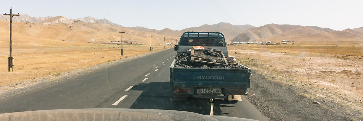 View out the front window of a Landcruiser being towed by a truck