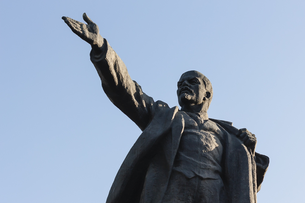 A Lenin statue in Bishkek, with arm outstretched showing the way to Communism